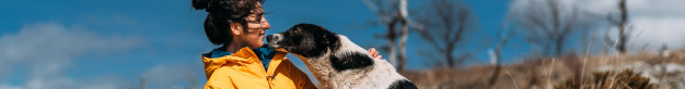 PET CHECK UK Woman and dog mountain holiday