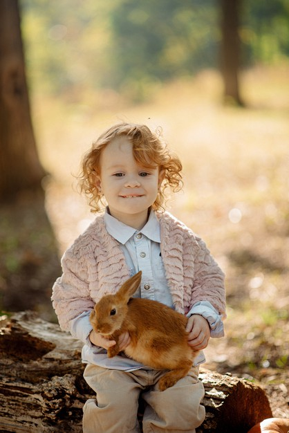 Little girl with a rabbit sitting on her lap