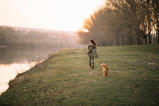 Woman and dog near river