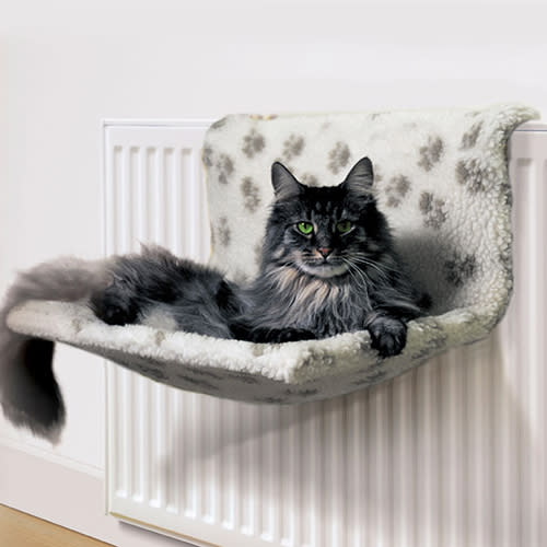 Radiator pet bed with cat lying in it
